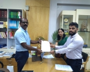 Mr. Prabhanand Hegde of CFAR and Kathyayini Chamaraj of CIVIC handing over Memorandum to Mr. Manivannan, Labour Secretary